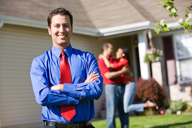 depositphotos_24358251-Home-Agent-with-Excited-Couple-in-Background